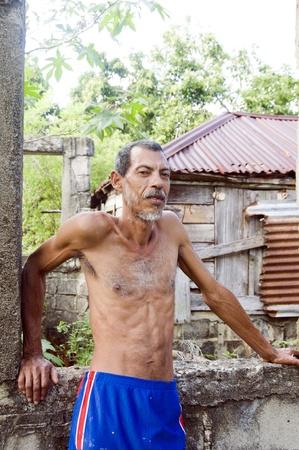emaciated: native Nicaraguan man portrait zinc wood house Corn Island Nicaragua