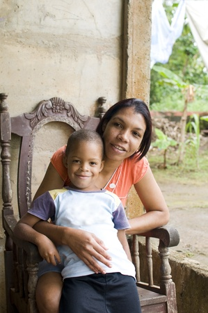 poor woman: mother with children house Nicaragua Corn Island Stock Photo