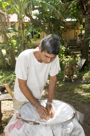 shredded coconut: man hand making coconut oil shredded coconut Nicaragua Corn Island Central America Stock Photo
