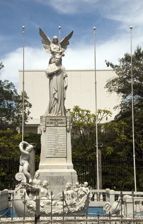 statue Ruben Dario in Plaza of the Revolution Republic Managua Nicaragua with Ruben Dario National Theater in the background Stock Photo