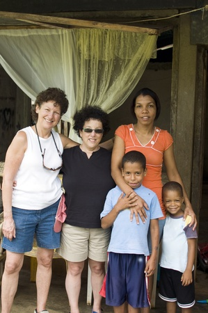 corn island: two white senior tourists with native mother sons family Corn Island Nicaragua