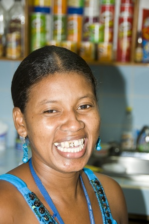 corn island:  NICARAGUA-JANUARY 29:  Native black Hispanic Latin woman smiling with common cosmetic decorative gold tooth design in Corn Island, Nicaragua, Central America .