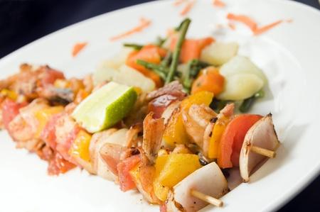 chili's restaurant: shrimp kabob on skewer fresh vegetables Latin style as photographed in Granada Nicaragua