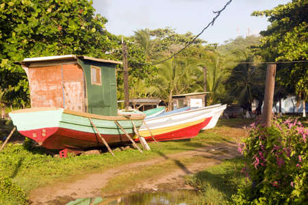colorful native fishing boats in tropical jungle Big Corn Island Nicaragua Stock Photo - 12410949