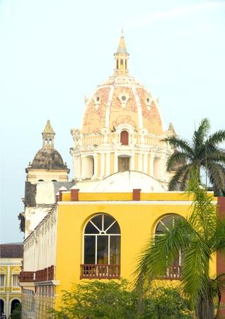santo: dome of Iglesia Chursh of Santo Domingo and Naval Museum palm tree Cartagena de Indias Colombia South America
