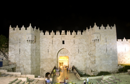 Damascus Gate entrance Old City Jerusalem Palestine Israel night light long exposure motion blur faces