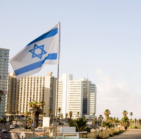 israeli: skyline cityscape with national Israeli flag and high rise hotel buildingsTel Aviv Israel Stock Photo