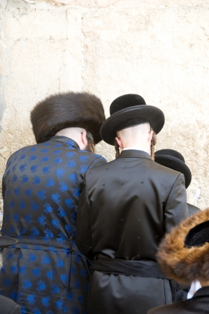 hasidic: JERUSALEM-MAY 28  Hasidic Chassidic Jews wearing traditional clothing are seen praying at The Western Wall Jerusalem, Israel, Palestine on May 28, 2012