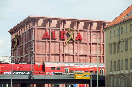 alexa: Berlin-May 11  The modern and popular Alexa shopping center mall is seen with train on elevated track running by the Alexanderplatz in Berlin, Germany on May 11, 2012