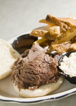 brisket beef sandwich with cole slaw steak fries barbecue sauce at kosher Jewish delicatessen Stock Photo - 14787714