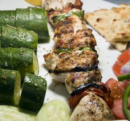 kabob: chicken shish kabob with zucchini and salad Greek style as photographed in Milos Greek Cyclades Island
