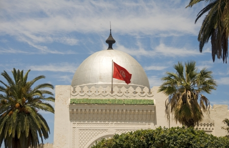landmark large silver dome mosque Sousse Tunisia Africa with national flag flying photo