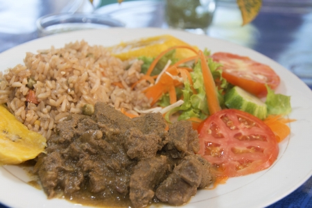 beef stew with rice garden salad in Bequia St  Vincent and the Grenadines Stock fotó