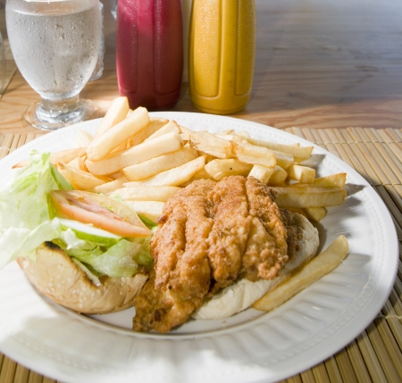 catsup: flying fish sandwich Caribbean style French fries lettuce tomato photographed in St  Lawrence Gap Barbados