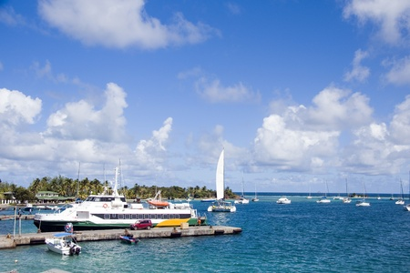 windward: harbor port with jetty hotel passenger ferry and yacht sailboats Clifton Union Island St. Vincent and the Grenadines in Caribbean