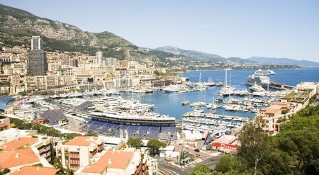 moorings:  The harbor of Monte Carlo is filled with yachts and cruise ships for the Grand Prix auto race of Monaco with grandstands in the streets of Monte Carlo, Monaco