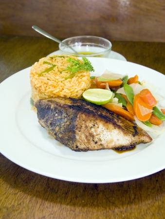 fresh Caribbean style yellowfin tuna steak with vegetables rice as photographed in Union Island St. Vincent and the Grenadines photo