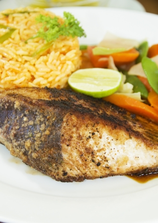 caribbean food: fresh Caribbean style yellowfin tuna steak with vegetables rice as photographed in Union Island St. Vincent and the Grenadines