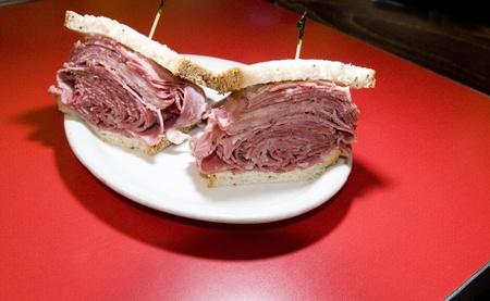 jewish cuisine: combination tongue corned beef sandwich on seeded rye bread at Jewish deli New York City