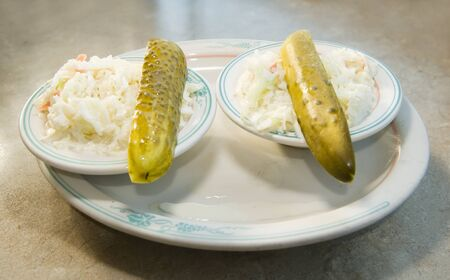 cole: pickles and cole slaw appetizer at diner restaurant