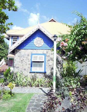 grenadines: Caribbean style stone building with gingerbread trim Bequia St  Vincent and the Grenadines town of Port Elizabeth