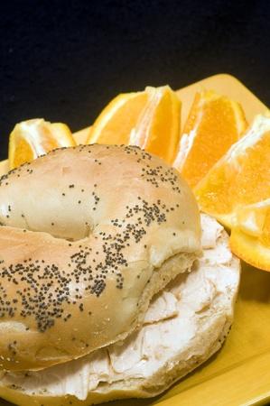 navel orange: poppy seed bagel with smoked salmon cream cheese spread and fresh navel orange