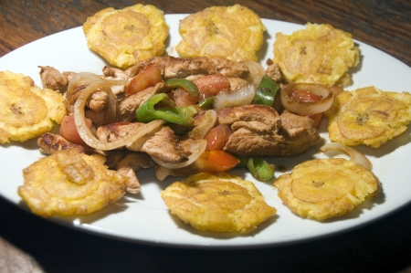 corn island: grilled chicken fajita food with local tostones fried plantains as photographed in Big Corn Island Nicaragua Central America