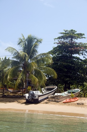 fishing boat on sandy beach shore Little Corn Island Nicaragua Central America Stock Photo - 19041174