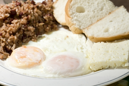 nicaraguan: Nicaraguan cheese fried eggs breakfast with rice and bean gallo pinto as photographed in Big Corn Island Nicaragua
