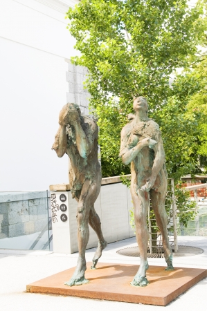 adam eve: sculpture statues Adam and Eve banished from paradise on The Butcher Stock Photo