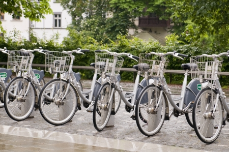 LJUBLJANA, SLOVENIA-MAY 24  Bicycles for rent in rack are seen in Ljubljana, Slovenia along the Ljubljanica river on May 24, 2013   The bike rental program is new along with a growing tourism industry in Slovenia  Stock Photo - 20425092