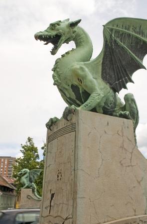 dragon sculpture statue on Dragon Bridge on Ljubljanica River Ljubljana Slovenia Europe