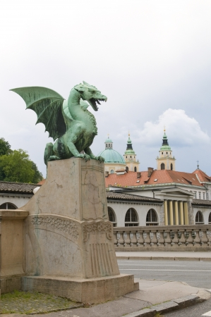 st nicholas cathedral: dragon sculpture on Dragon Bridge view of Cathedral Saint Nicholas old city on Ljubljanica River Ljubljana Slovenia Europe
