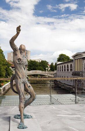 statue of Prometheus on Butchers Bridge with padlocks Ljubljanica River Ljubljana Slovenia Europe