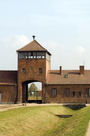 infamous iconic train entry gate building Birkenau German Nazi Concentration death camp Poland