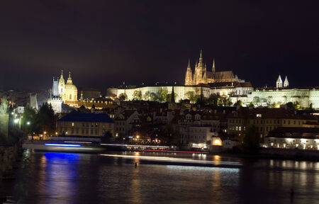 castle district: panoramic view Charles Bridge Vlatava River Castle district with cruise ship night light streaks
