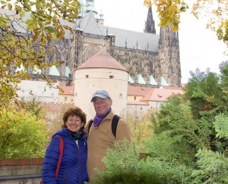 castle district: middle age senior smiling man woman tourist couple Castle District Prague Czech Republic Editorial
