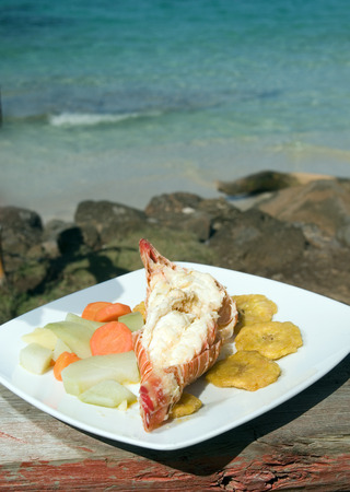 corn island: fresh Caribbean lobster tails cooked garlic and butter with local vegetables as photographed in Big Corn Island Nicaragua Central America