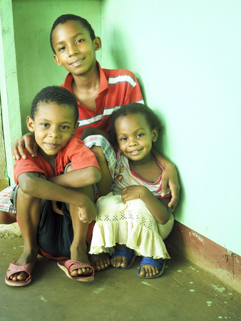 corn island: BIG CORN ISLAND, NICARAGUA-NOVEMBER  8:  Family portrait of three unidentified young brothers and sister happy and smiling on Big Corn Island, Nicaragua, Central America on November 8, 2014.