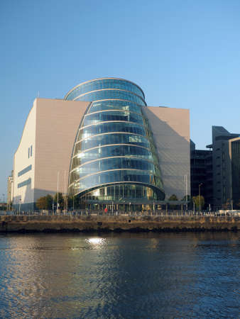 modern architecture new glass curved angled  Convention Center Centre Dublin Ireland europe River Liffy in Docklands Фото со стока