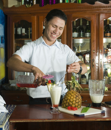 Big Corn Island, Nicaragua-April 2: Bartender mixing fresh pineapple pina colada at bar in hotel in Big Corn Island, Nicaragua, Central America on April 2, 2014.