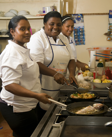 Big Corn Island, Nicaragua-April 2: Cooks and kitchen staff are seen cooking fish and vegetables in hotel in Big Corn Island, Nicaragua, Central America on April 2, 2014.