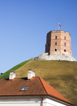 historic Gedimino Fort Tower on Gediminas Hill in old district Vilnius, Lithuania Редакционное
