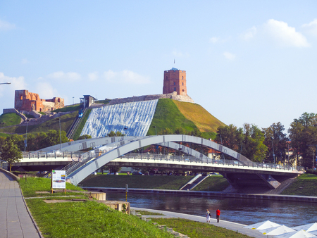 Vilnius, Lithuania Gediminas Hill with funicular at Gediminas Fort Tower above Old Town on Neris River at Mindaugas Bridge