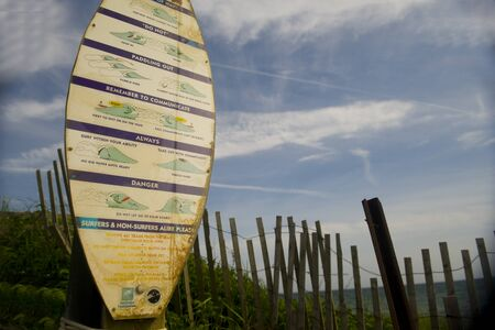 MONTAUK, NEW YORK-JUNE 8: Sign of surfer rules of etiquette on on surf boar in Ditch Plains Beach in Montauk, New York are seen on June 8, 2018. Редакционное