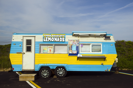 MONTAUK, NY-JUNE 8: A lemonade and ice cream wagon is seen in parking lot in Montauk, New York by popular surfing Ditch Plains Beach on June 8,2018. Редакционное