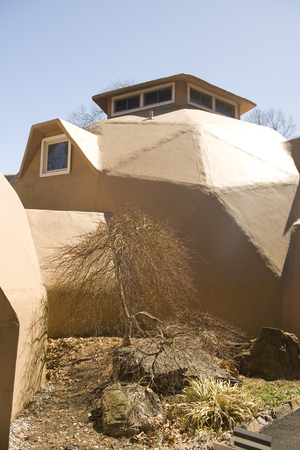 geodesic dome home residential house in suburban setting Редакционное