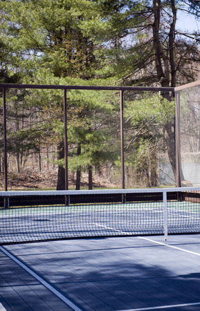 platform tennis paddle court in woods in suburban setting private club Фото со стока