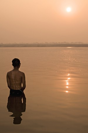 ganges: Hindu pilgrim take a bath in the ganges river in Varanasi, India. Stock Photo