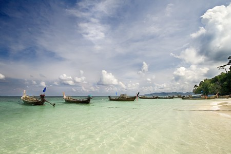 boats on a clear water beach, Phuket Island, Thailand